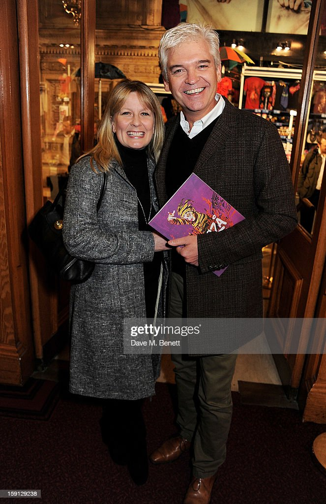 Stephanie Lowe (L) and <a gi-track='captionPersonalityLinkClicked' href=/galleries/search?phrase=Phillip+Schofield&family=editorial&specificpeople=629203 ng-click='$event.stopPropagation()'>Phillip Schofield</a> arrive at the opening night of Cirque Du Soleil's Kooza at Royal Albert Hall on January 8, 2013 in London, England.