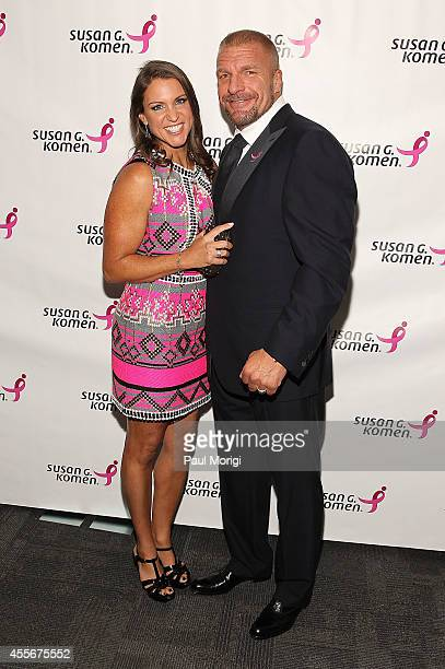 Stephanie McMahon Chief Brand Officer WWE and Paul Michael Levesque attend the 2014 Susan G Komen Honoring The Promise Gala at John F Kennedy Center...