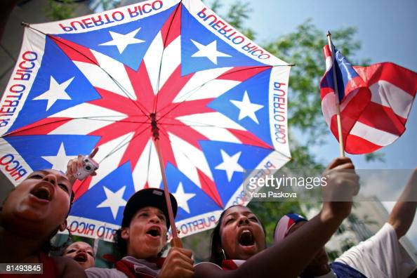 Stephanie Morales Christian Ortiz and Simone Sonii cheer at the annual Puerto Rico Day Parade June 8 2008 in New York City The parade honoring Puerto...
