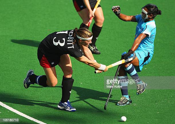 Stephanie Nesbitt of Canada has her shot on goal blocked by Joydeep Kaur of India during the Women's Semifinal match between Australia and England at...