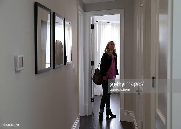 Stephanie O'Brien inspects a bedroom in a home for sale during an open house on May 28 2013 in San Francisco California According to the Standard...