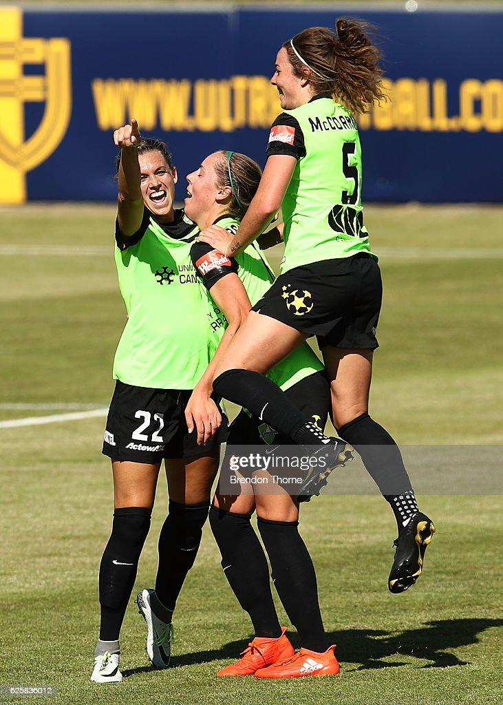 Stephanie Ochs of Canberra celebrates with team mates after scoring a goal during the round four W-League match between Canberra United and the Newcastle Jets at McKellar Park on November 26, 2016 in Canberra, Australia.