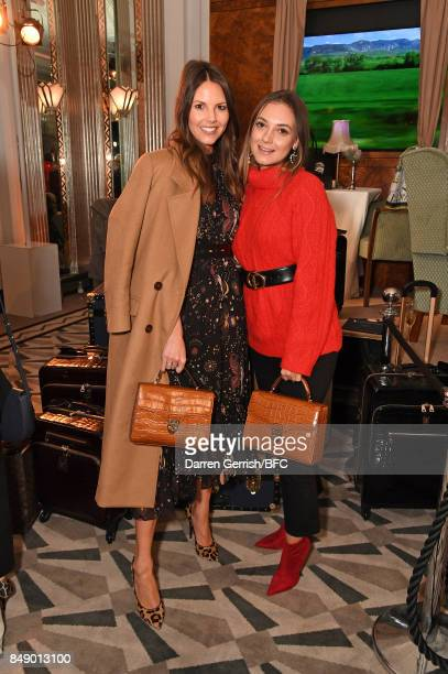 Stephanie Peers and Andreea Cristea attend the Aspinal of London presentation during London Fashion Week September 2017 on September 18 2017 in...