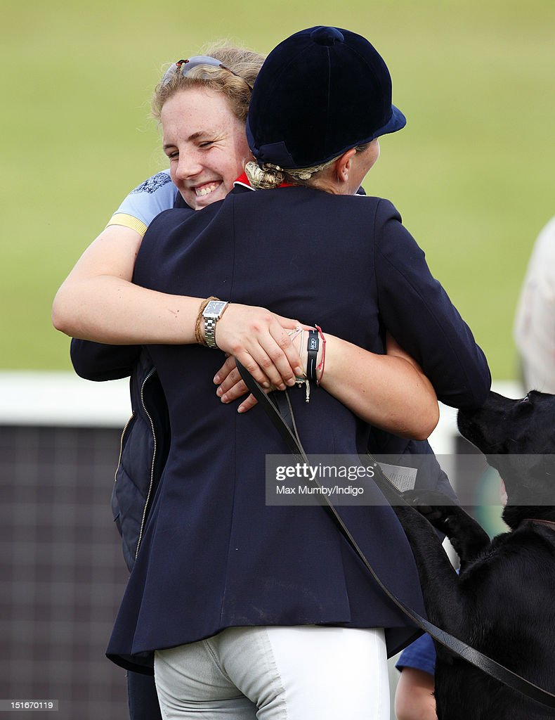Stephanie Phillips hugs her half sister Zara Phillips as they attend the Blenheim Palace International Horse Trials at Blenheim Palace on September 9, 2012 in Woodstock, England.