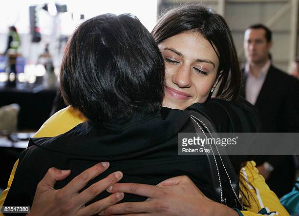 Stephanie Rice hugs her mother Raylene Keane as the Australian Olympic team arrive home at Sydney Airport following the Beijing 2008 Olympics August...