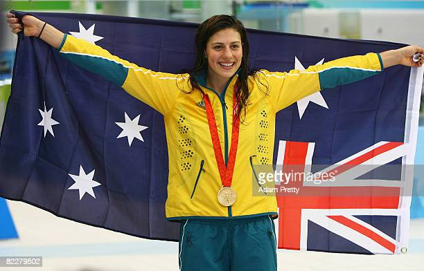 Stephanie Rice of Australia poses with the gold medal during the medal ceremony for the Women's 200m Individual Medley held at the National Aquatics...