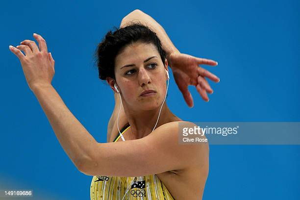 Stephanie Rice of Australia stretches during a training session ahead of the London Olympic Games at the Aquatics Centre in Olympic Park on July 24...