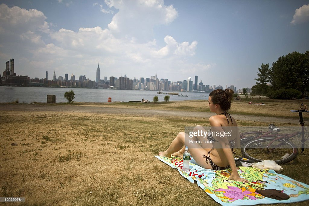 Stephanie Smith of Greenpoint, Brooklyn relaxes in the East River State Park on July 6, 2010 in the Brooklyn borough of New York City. The National Weather Service has issued a heat advisory for parts of the Northeast, mid-Atlantic and parts of Michigan and Kentucky with temperatures in some areas predicted to reach 100 degrees.