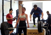 Stephanie St Claire does a deadlift during a CrossFit workout at Ross Valley CrossFit on March 14 2014 in San Anselmo California CrossFit a high...