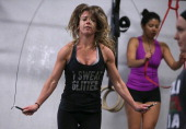 Stephanie St Claire jumps rope during a CrossFit workout at Ross Valley CrossFit on March 14 2014 in San Anselmo California CrossFit a high intensity...