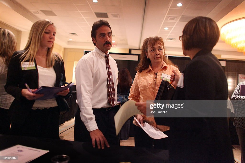 Stephanie Stanford (L-R), Peter Hardy and Luz Valasquez speak with Diane-Brito Wigfall as she recruits workers for Talent Tree at a job fair put on by Monster.com on November 5, 2009 in Fort Lauderdale, Florida. The Monster's 'Keep America Working Tour', is helping workers find jobs as the US employment report for October, which comes out tomorrow, is expected to show that the jobless rate stayed close to a 26-year high of 9.8 per cent in September.