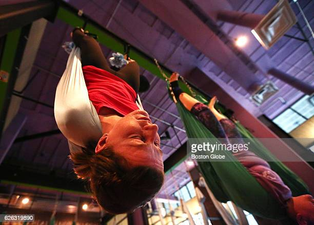 Stephanie Starr of Boston left and Arleigh Kennedy of North Reading hang in a 'shoulder stand' during a firsttimers AntiGravity class at Swet Studio...