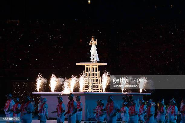 Stephanie Sun performs on stage during the National Day Parade at Padang on August 9 2015 in Singapore Singapore is celebrating her 50th year of...