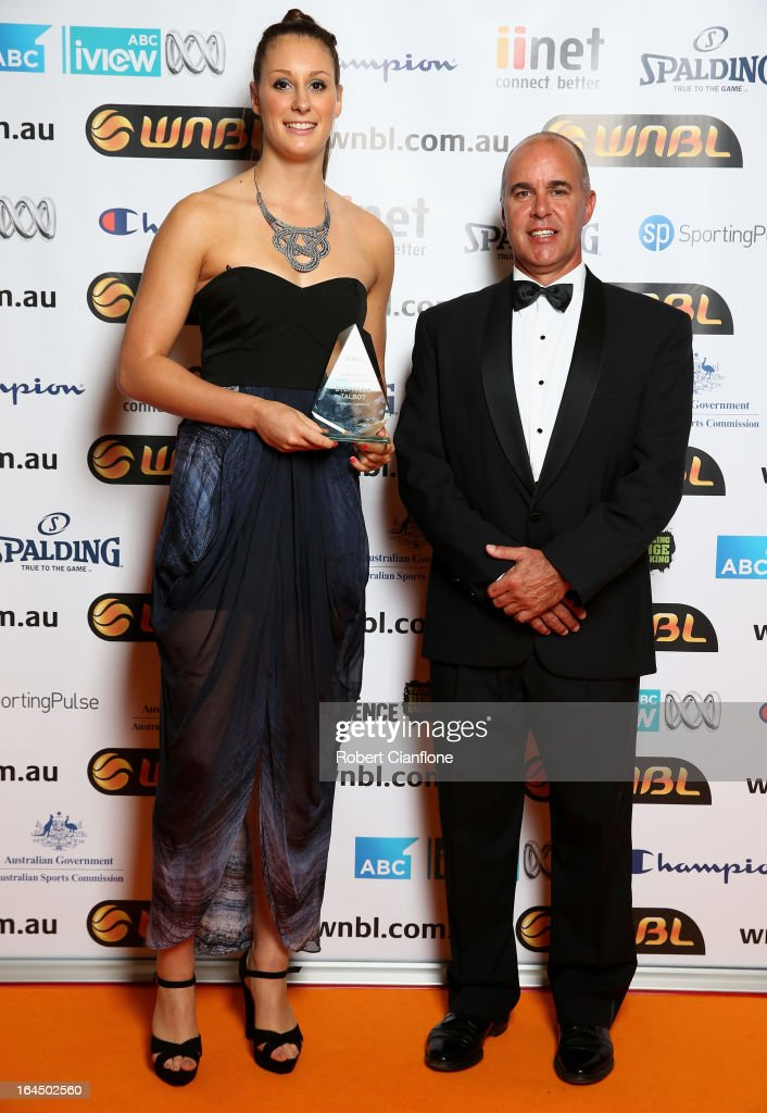 Stephanie Talbot of the Adelaide Lighting poses with Bruce Abraham after winning the Rookie Of the Year Award during the 2013 Basketball Australia MVP Awards at Crown Palladium on March 24, 2013 in Melbourne, Australia.
