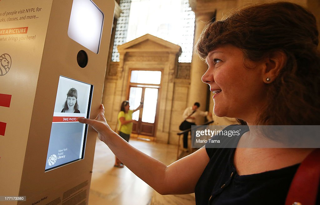 Stephanie Thompson takes a 'selfie' at a new photobooth in the New York Public Library on August 21, 2013 in New York City. Visitors are invited to take pictures of themselves in the library which will be placed on the library's website and also emailed to the user.