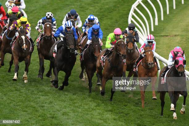 Stephanie Thornton riding Here To There turns into the home straight before winning Race 8 during Melbourne Racing at Moonee Valley Racecourse on...