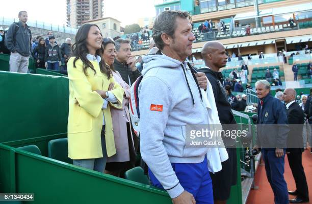 Stephanie Tuccitto and Thierry Van Cleemput coach of David Goffin celebrate David's victory over Novak Djokovic following his quarter final on day 6...