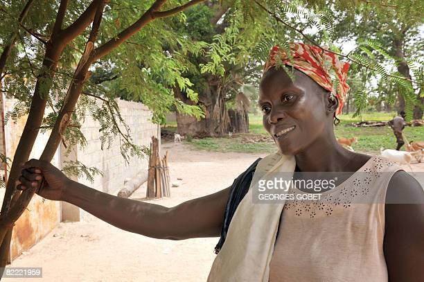 Stephanie van den Berg Delphine who say she has collected the fruits of Boabab trees since she was a little girl poses on July 25 2008 in the village...
