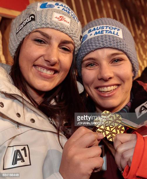 Stephanie Venier and World Champion Nicole Schmidhofer of Austria pose after the podium ceremony of the women's SuperG race at the 2017 FIS Alpine...