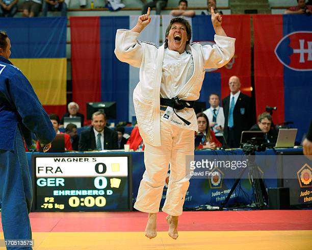Stephanie Wagner of France reacts after defeating Daniela Ehrenberg of Germany by a shido penalty to win the u78kgs F2 gold medal during day one of...