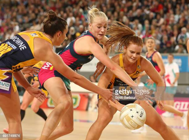 Stephanie Wood of the Lightning and Joanna Weston of the Vixens compete for the ball during the Super Netball Major Semi Final match between the...