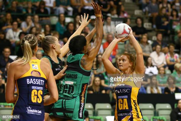 Stephanie Wood of the Lightning sets to put a shot up against Stacey Francis of the Fever during the round six Super Netball match between the Fever...