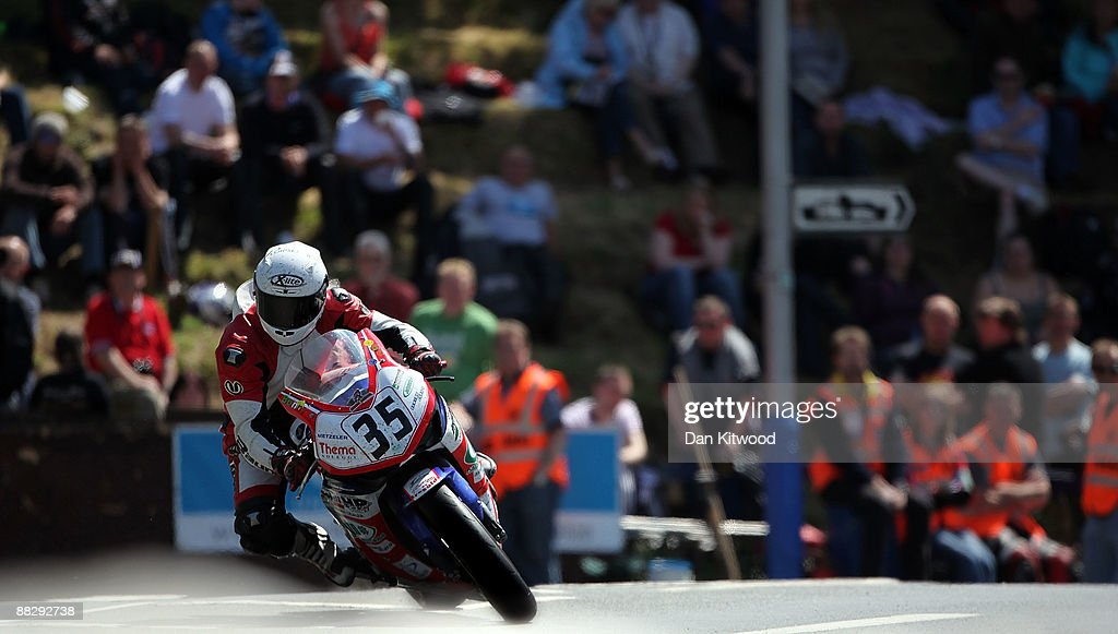 Stephano Bonetti takes the corner at Quarterbridge during the superbike TT race in Douglas on June 8, 2009, Isle Of Man, United Kingdom. The annual TT race is one of the highlights of the motorbike racing calender with fans travelling from around the globe to watch riders compete in the 37 and three quarter mile lap exceeding speeds of 200mph.