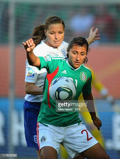 Stephany Mayor of Mexico is challenged by Rachel Unitt of England during the FIFA Women's World Cup 2011 Group B match between Mexico and England at...