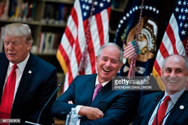 Stephen A Schwarzman CEO of the Blackstone Group and Chris Liddell White House Director of Strategic Initiatives laugh before a meeting with US...