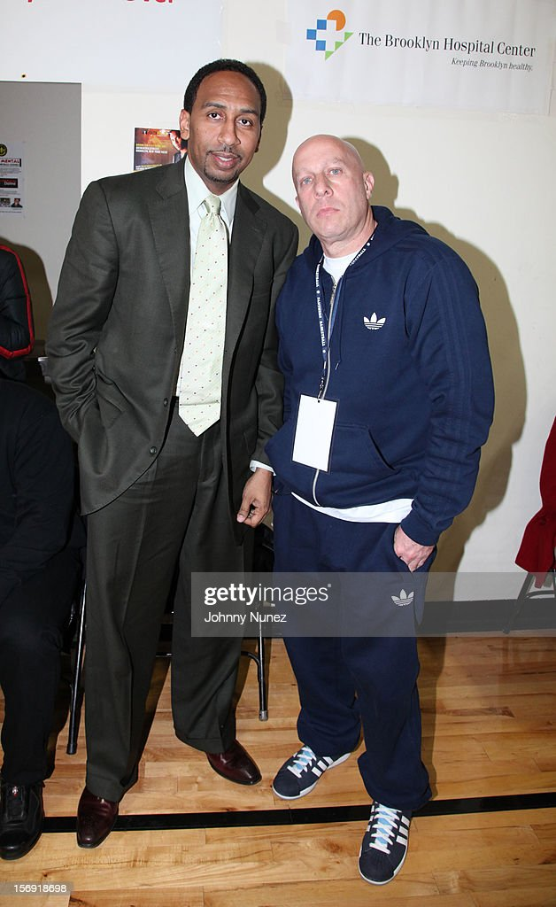 Stephen A. Smith and Steve Lobel attend the 2012 High School Basketball Showcase at Bedford Academy on November 24, 2012 in the Brooklyn borough of New York City.