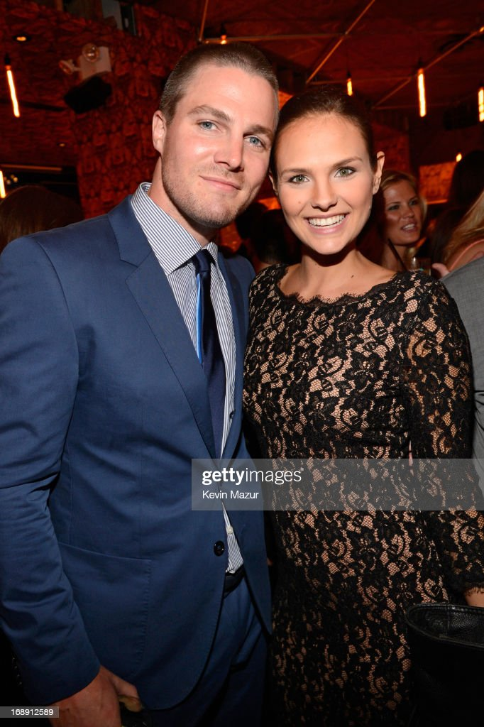 <a gi-track='captionPersonalityLinkClicked' href=/galleries/search?phrase=Stephen+Amell&family=editorial&specificpeople=4500297 ng-click='$event.stopPropagation()'>Stephen Amell</a> and Cassandra Jean attend The CW Network's 2013 Upfront party at FINALE on May 16, 2013 in New York City.