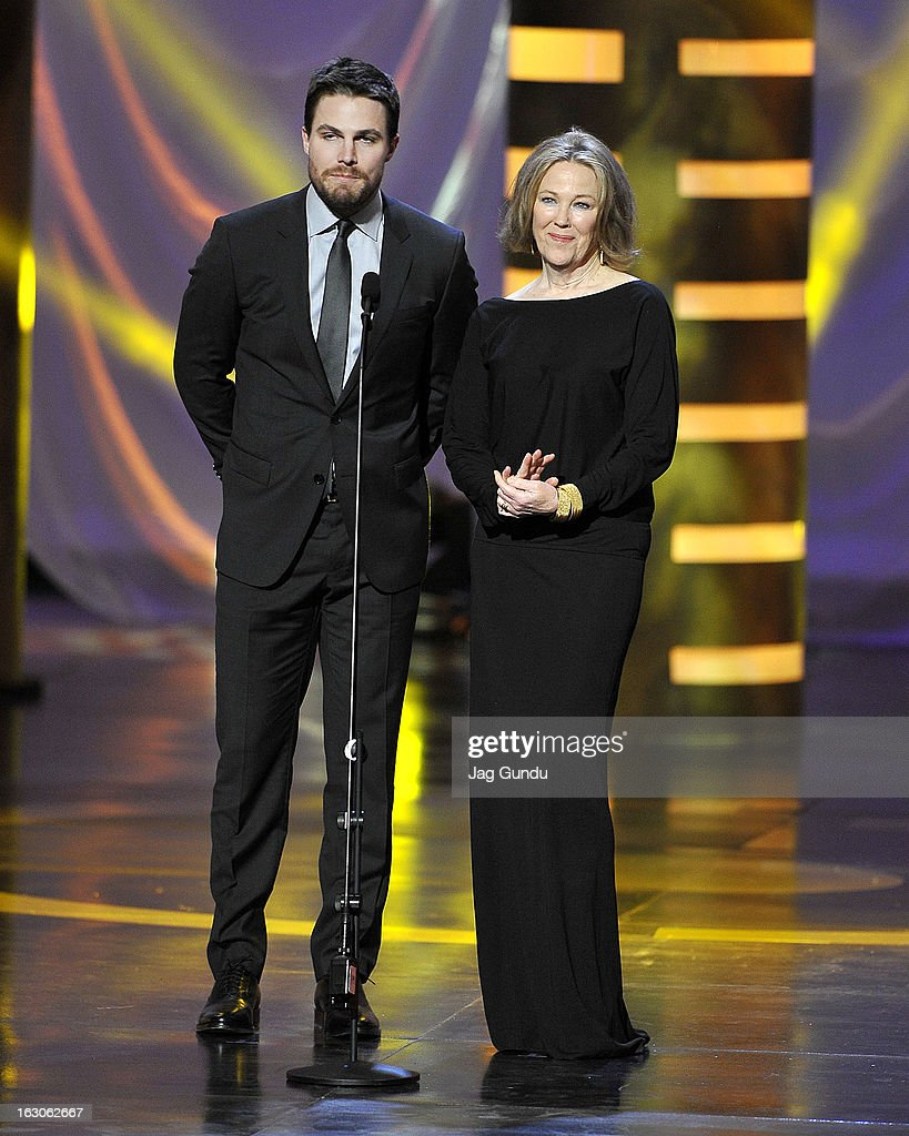<a gi-track='captionPersonalityLinkClicked' href=/galleries/search?phrase=Stephen+Amell&family=editorial&specificpeople=4500297 ng-click='$event.stopPropagation()'>Stephen Amell</a> and Catherine O'hara present at the 2013 Canadian Screen Awards at the Sony Centre for the Performing Arts on March 3, 2013 in Toronto, Canada.