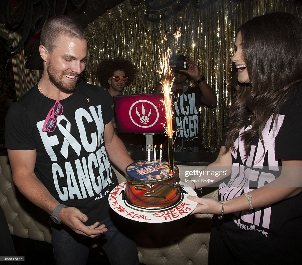 <a gi-track='captionPersonalityLinkClicked' href=/galleries/search?phrase=Stephen+Amell&family=editorial&specificpeople=4500297 ng-click='$event.stopPropagation()'>Stephen Amell</a> and Julie Greenbaum attend 2nd Annual F*ck Cancer Charity Event LA at Bootsy Bellows on May 9, 2013 in West Hollywood, California.