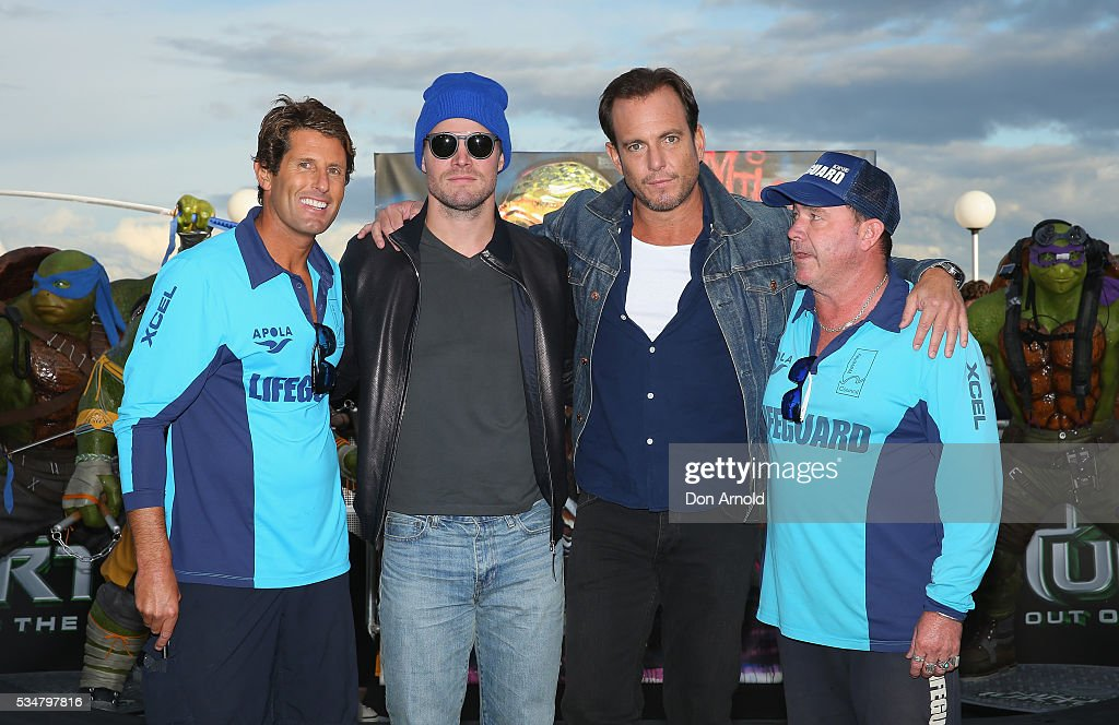 Stephen Amell and Will Arnett pose alongside Bondi lifeguards during a photo call ahead of the Australian premiere of Teenage Mutant Ninja Turtles 2 on May 28, 2016 in Sydney, Australia.