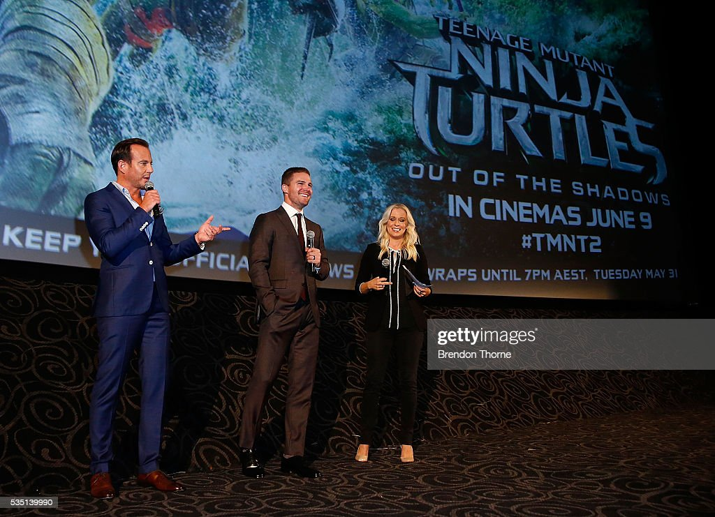 <a gi-track='captionPersonalityLinkClicked' href=/galleries/search?phrase=Stephen+Amell&family=editorial&specificpeople=4500297 ng-click='$event.stopPropagation()'>Stephen Amell</a> and <a gi-track='captionPersonalityLinkClicked' href=/galleries/search?phrase=Will+Arnett&family=editorial&specificpeople=209259 ng-click='$event.stopPropagation()'>Will Arnett</a> speak at a fan screening during the Australian premiere of Teenage Mutant Ninja Turtles 2 at Event Cinemas George Street on May 29, 2016 in Sydney, Australia.
