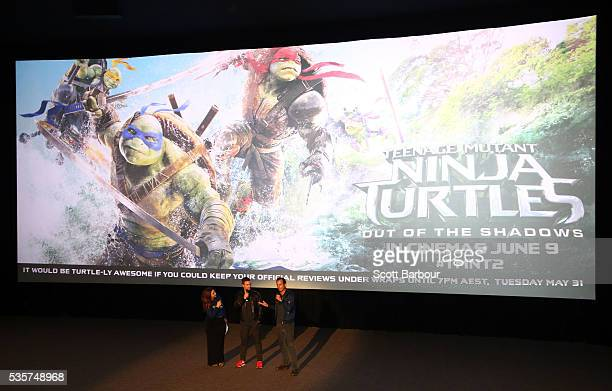 Stephen Amell and Will Arnett talk to the audience during the Teenage Mutant Ninja Turtles Out of the Shadows fan screening at Village Cinemas Jam...