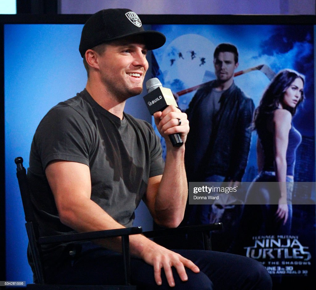 <a gi-track='captionPersonalityLinkClicked' href=/galleries/search?phrase=Stephen+Amell&family=editorial&specificpeople=4500297 ng-click='$event.stopPropagation()'>Stephen Amell</a> appears to promote 'Teenage Ninja Mutant Turtles: Out of the Shadows' during the AOL BUILD Series at AOL Studios In New York on May 25, 2016 in New York City.