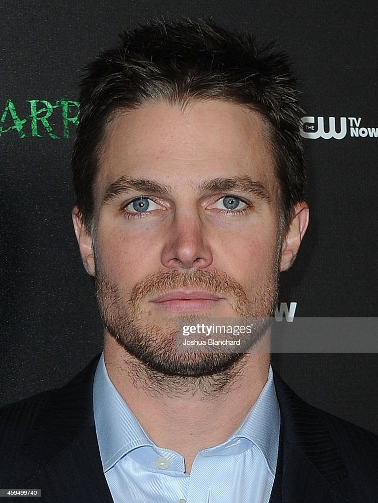 Stephen Amell arrives at a special screening for the CW's 'Arrow' And 'The Flash' at Crest Theatre on November 22, 2014 in Westwood, California.