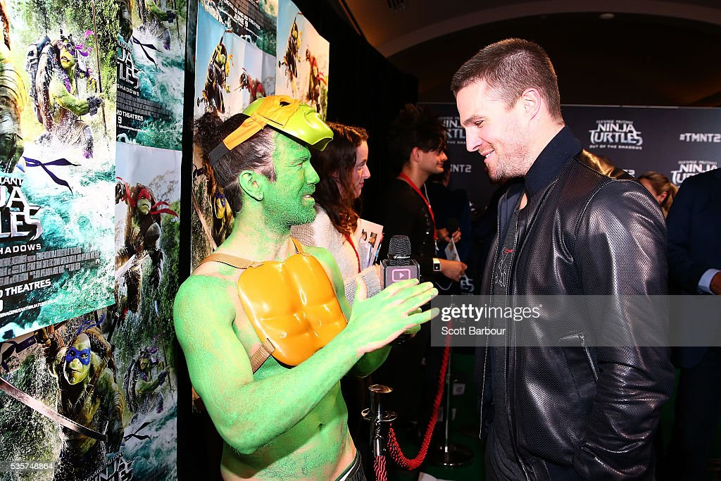 <a gi-track='captionPersonalityLinkClicked' href=/galleries/search?phrase=Stephen+Amell&family=editorial&specificpeople=4500297 ng-click='$event.stopPropagation()'>Stephen Amell</a> is interviewed as he attends the Teenage Mutant Ninja Turtles: Out of the Shadows fan screening at Village Cinemas Jam Factory on May 30, 2016 in Melbourne, Australia.