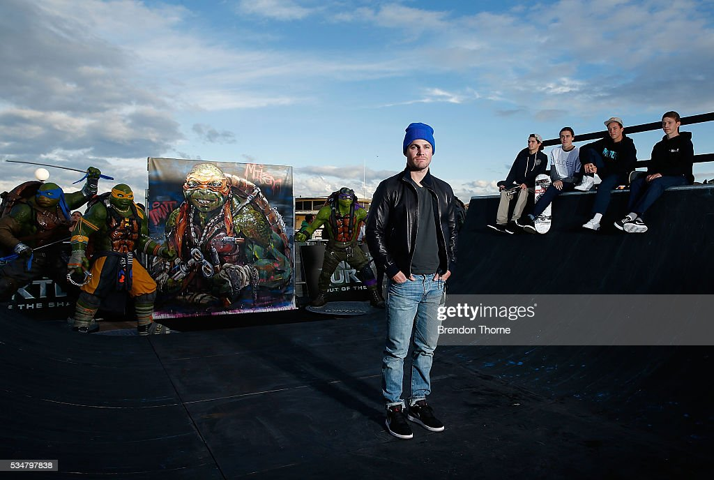 <a gi-track='captionPersonalityLinkClicked' href=/galleries/search?phrase=Stephen+Amell&family=editorial&specificpeople=4500297 ng-click='$event.stopPropagation()'>Stephen Amell</a> poses at Bondi beach during a photo call ahead of the Australian premiere of Teenage Mutant Ninja Turtles 2 on May 28, 2016 in Sydney, Australia.