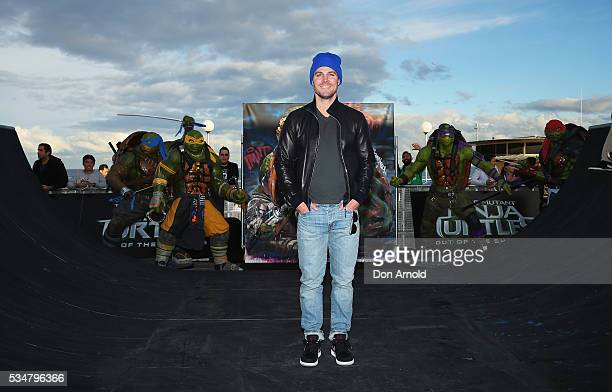 Stephen Amell poses during a photo call ahead of the Australian premiere of Teenage Mutant Ninja Turtles 2 on May 28 2016 in Sydney Australia