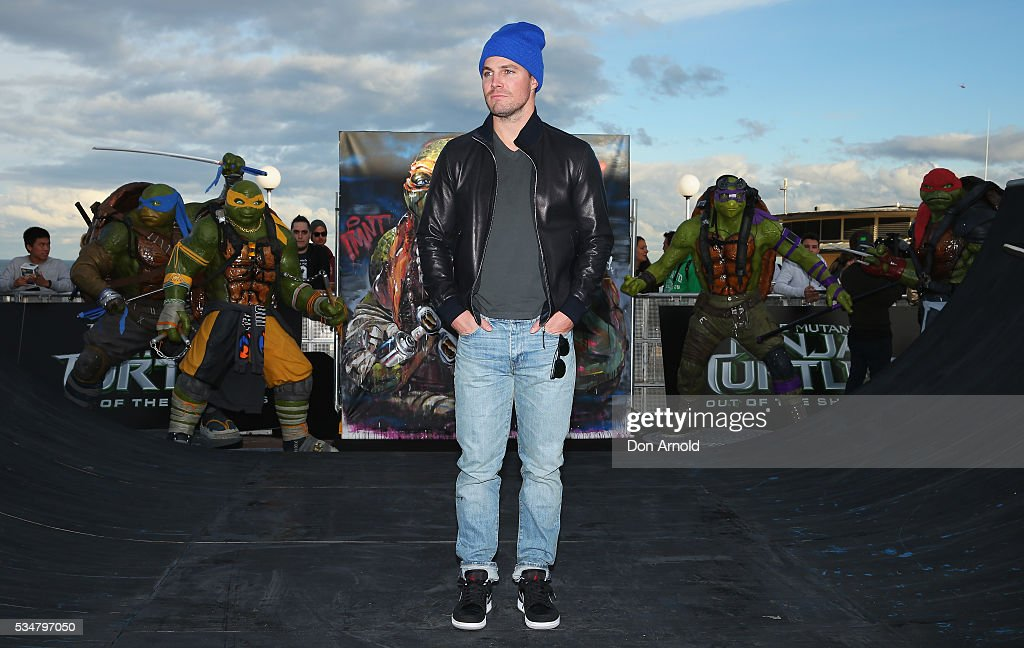 <a gi-track='captionPersonalityLinkClicked' href=/galleries/search?phrase=Stephen+Amell&family=editorial&specificpeople=4500297 ng-click='$event.stopPropagation()'>Stephen Amell</a> poses during a photo call ahead of the Australian premiere of Teenage Mutant Ninja Turtles 2 on May 28, 2016 in Sydney, Australia.