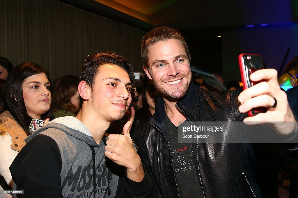 <a gi-track='captionPersonalityLinkClicked' href=/galleries/search?phrase=Stephen+Amell&family=editorial&specificpeople=4500297 ng-click='$event.stopPropagation()'>Stephen Amell</a> poses for photos with fans as he attends the Teenage Mutant Ninja Turtles: Out of the Shadows fan screening at Village Cinemas Jam Factory on May 30, 2016 in Melbourne, Australia.