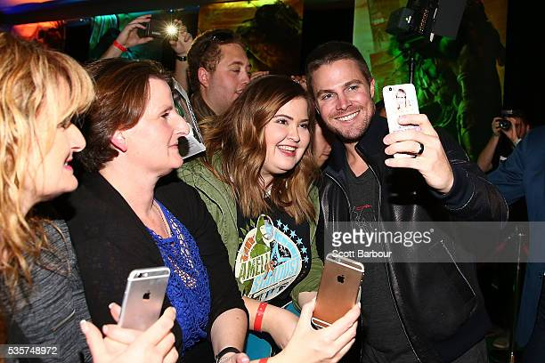 Stephen Amell poses for photos with fans as he attends the Teenage Mutant Ninja Turtles Out of the Shadows fan screening at Village Cinemas Jam...