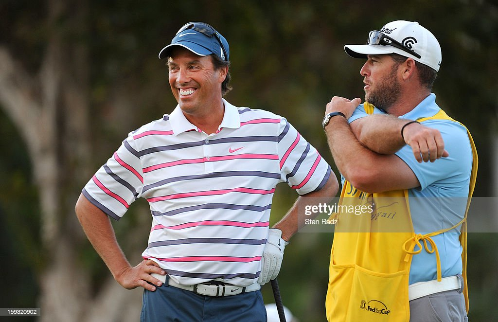 Stephen Ames (L), from Trinidad waits to play the first hole during the second round of the Sony Open in Hawaii at Waialae Country Club on January 11, 2013 in Honolulu, Hawaii.