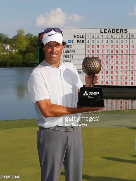Stephen Ames holds up the tournament trophy after winning the 2017 Mitsubishi Electric Classic golf tournament at the TPC Sugarloaf Golf Club Sunday...
