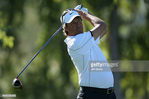 Stephen Ames of Canada hits a tee shot on the second hole on the Arnold Palmer Private Course at PGA West during the first round of the Humana...
