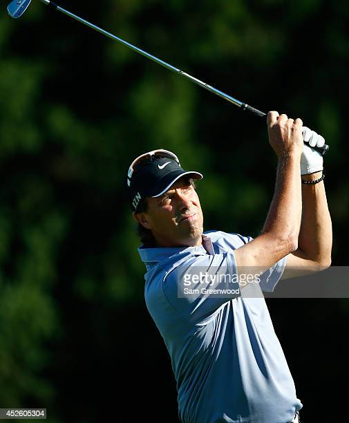 Stephen Ames of Canada hits his approach on the eighth hole during the first round of the RBC Canadian Open at the Royal Montreal Golf Club on July...