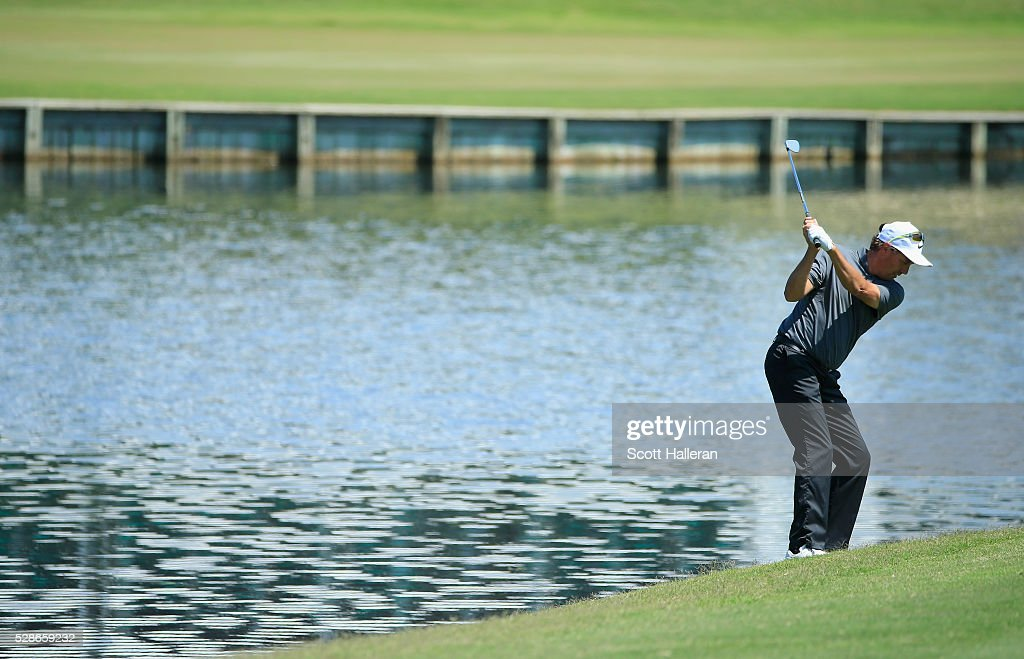 Stephen Ames of Canada hits his approach shot on the 17th hole during the first round of the Insperity Championship at The Woodlands Country Club on May 06, 2016 in The Woodlands, Texas.
