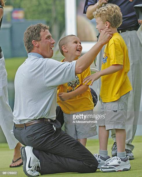 Stephen Ames plays with sons Ryan and Justin after winning the Cialis Western Open in Lemont Illinois on July 4 2004